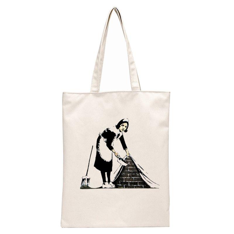 Mona Lisa Sweeping under - Banksy tote bags